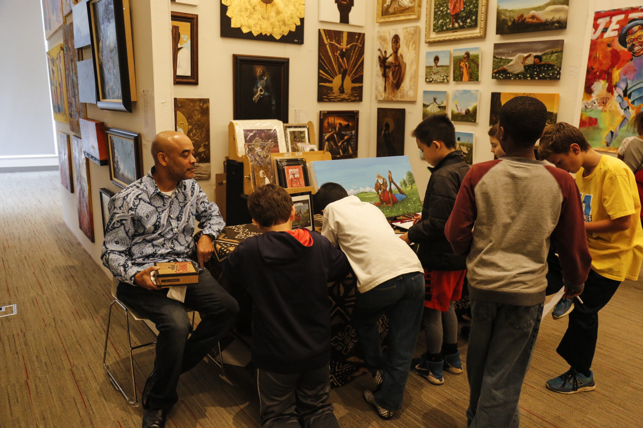 Local students participate in a day of art enrichment and inspiration with artist Jerome T. White.