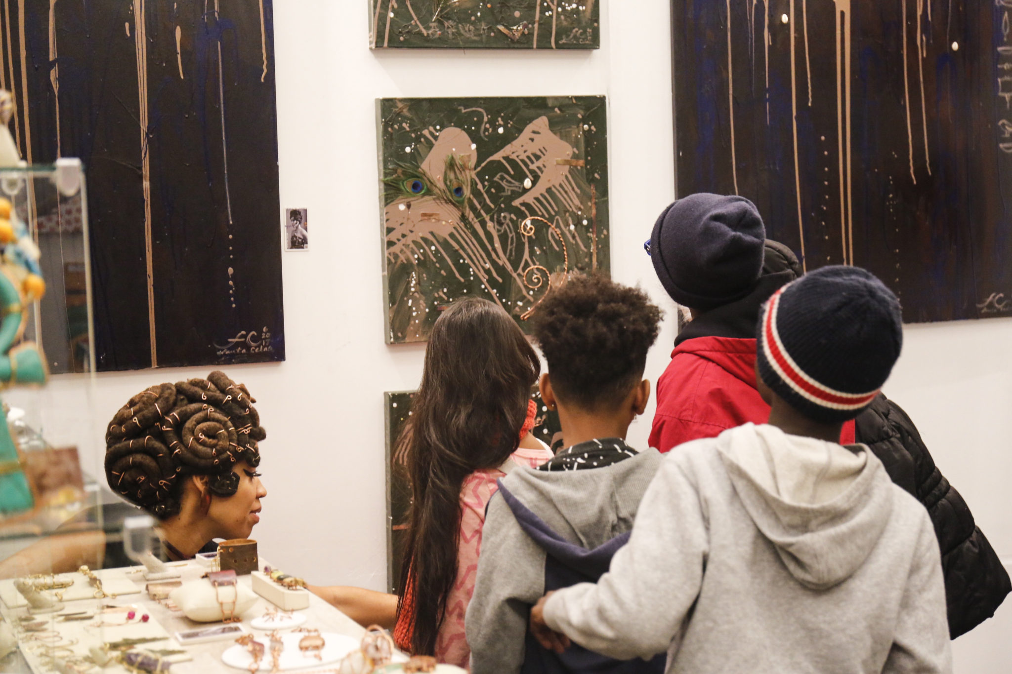 Local school kids take a tour of the showcase of diverse artists the 2017 Harlem Fine Arts Show.
