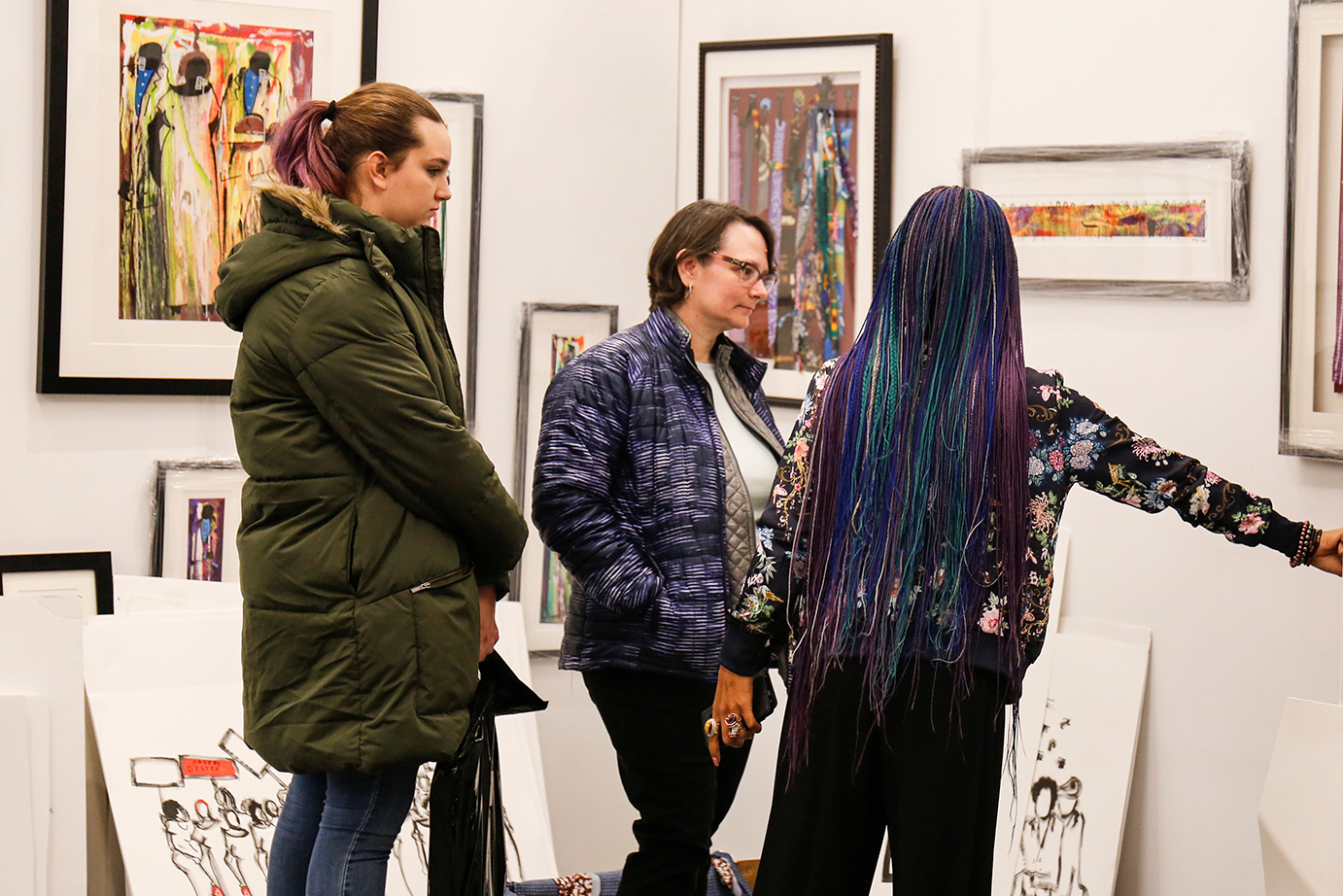 Guests engaging with art and artist