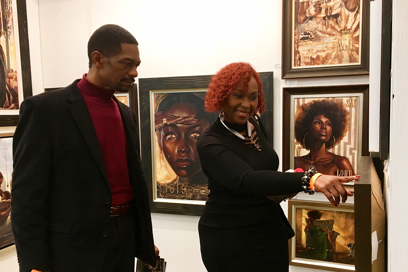 Guests admire a particular piece of art by artist Kevin Williams
